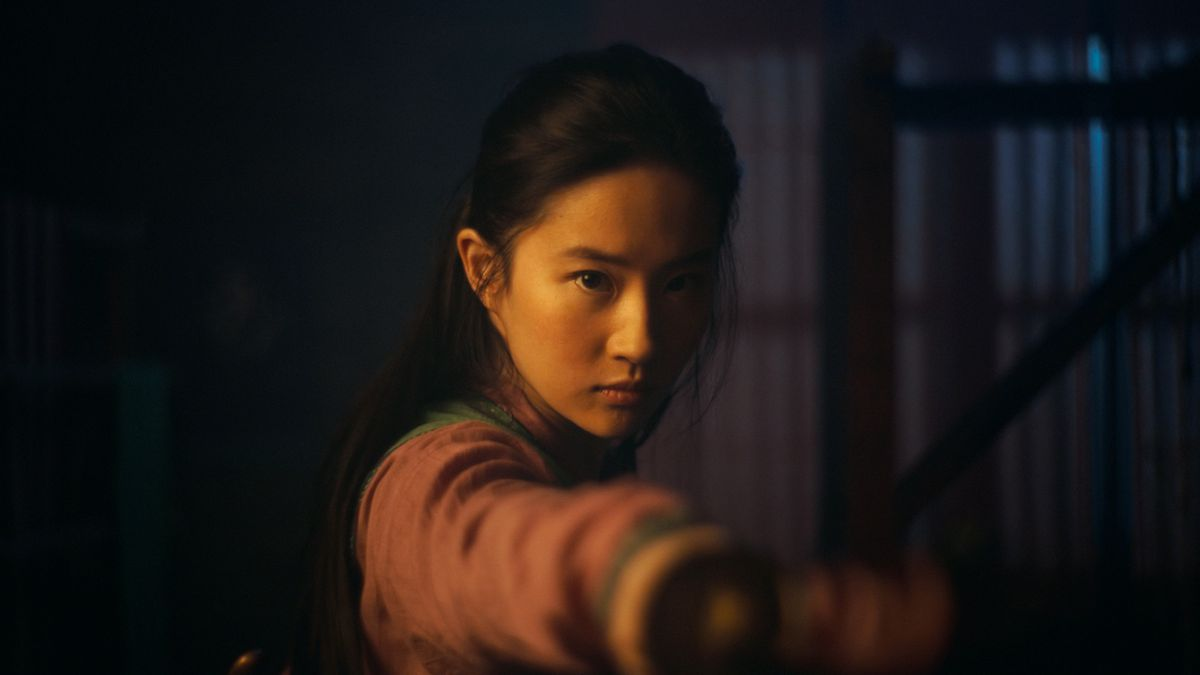 """This image released by Disney shows Yifei Liu in the title role of """"Mulan.""""  The film is no longer headed for a major theatrical release. The Walt Disney Co. said Tuesday that it will debut its live-action blockbuster on its subscription streaming service, Disney+, on Sept. 4. Customers will have to pay an additional $29.99 on top of the cost of the monthly subscription to rent """"Mulan."""""""