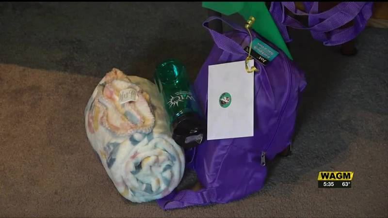 A go bag includes a blanket, necessities like a toothbrush, and products for more creative...