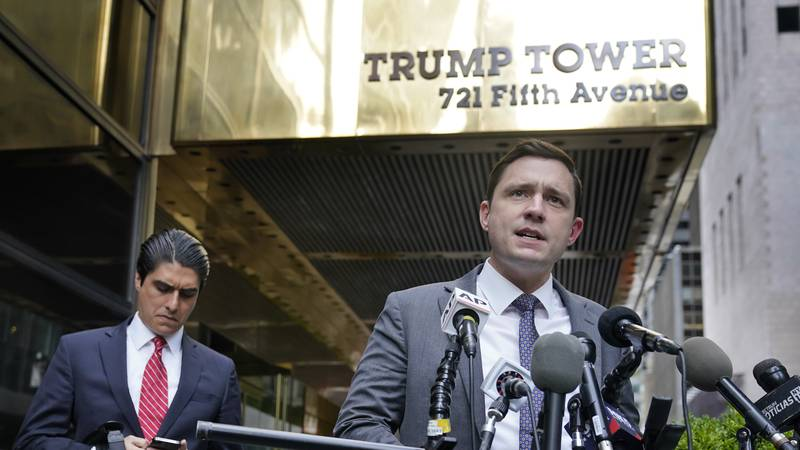 Lawyer Benjamin Dictor, right, speaks to reporters after helping to depose former President...