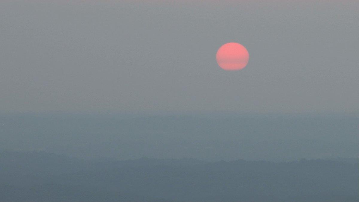Red sun in hazy skies