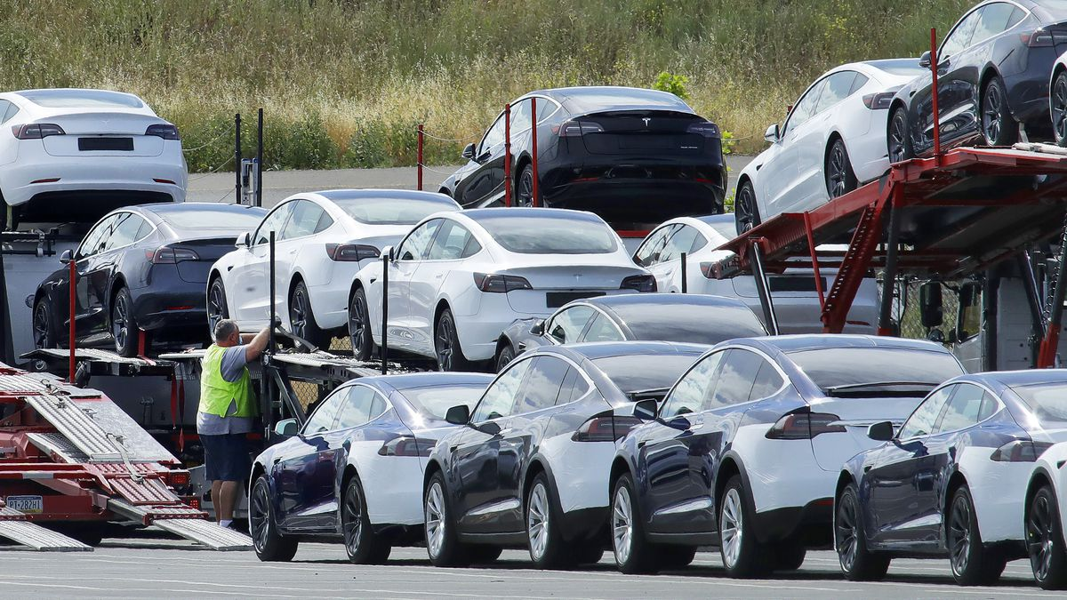 FILE - In this May 13, 2020, file photo, Tesla cars are loaded onto carriers at the Tesla electric car plant in Fremont, Calif. California Gov. Gavin Newsom said Wednesday, Sept. 23 that the state will halt sales of new gasoline-powered passenger cars and trucks by 2035. He ordered state regulators to come up with requirements to meet that goal. California would be the first state with such a rule, though Germany and France are among 15 other countries that have a similar requirement.