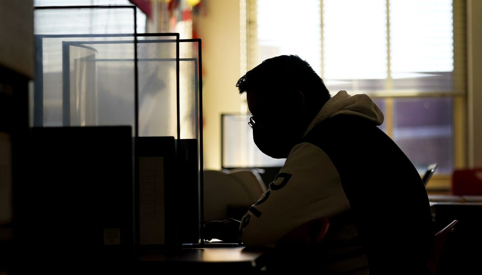 Senior Jose Solano-Hernandez takes a test on the first day of in-person learning at Wyandotte...