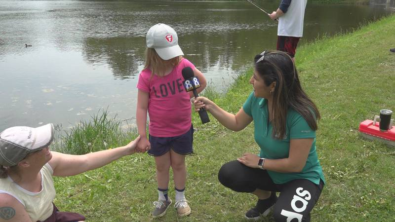 NewsSource 8 Reporter talking to Lydia Brown