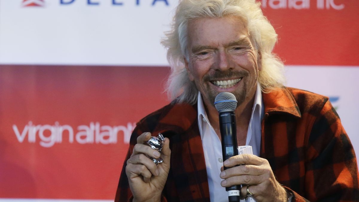 Richard Branson, founder of Virgin Atlantic and the Virgin Group, holds a pair of his airline's often-pilfered airplane-shaped salt and pepper shakers that he said he pocketed while on a flight from London to Seattle, Monday, March 27, 2017, as he speaks during a news conference at Seattle-Tacoma International Airport in Seattle.