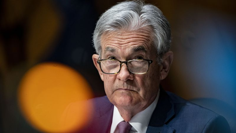 FILE - In this Dec. 1, 2020 file photo, Federal Reserve Chair Jerome Powell listens during a...