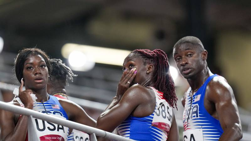 Lynna Irby of the United States wipes a tear away after the 4 x 400-meter mixed relay at the...