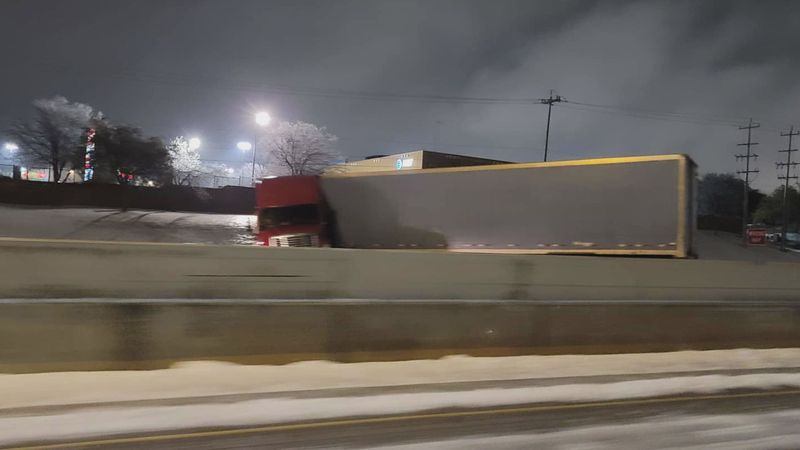 A truck in Texas losing control due to the ice road conditions