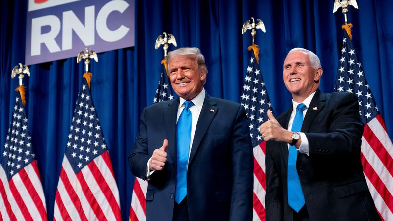 President Donald Trump and Vice President Mike Pence stand on stage during the first day of the...