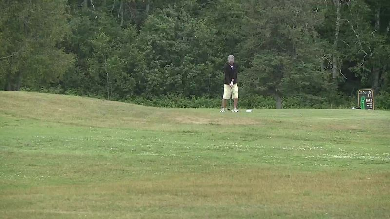 Golfers are enjoying a round of golf at Limestone Country Club