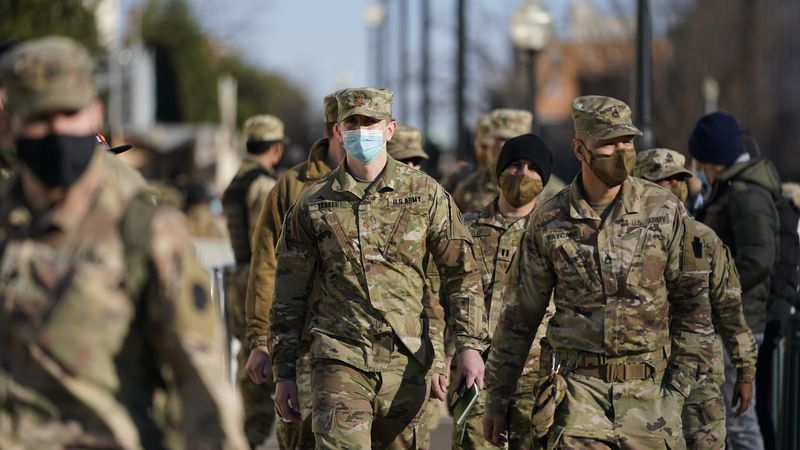 Member of the DC National Guard walk around the U.S. Capitol grounds, Thursday morning, Jan. 7,...