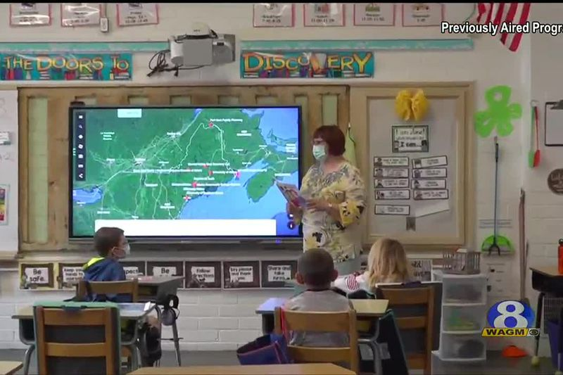 Lise Pelletier teaches Dr Levesque Elementary's 2nd grade class about Acadian culture