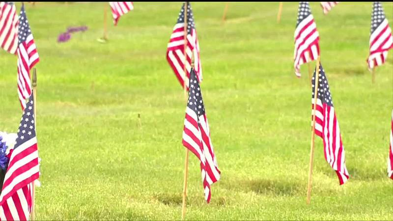 Flags on the graves at Northern Maine Veterans' Cemetery
